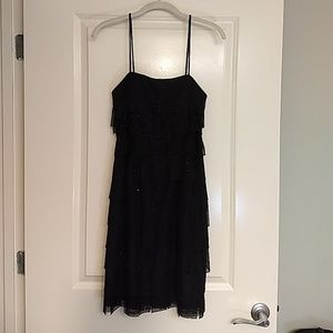 Black spaghetti strap cocktail dress.